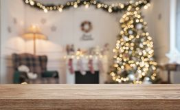 Wooden table over defocused christmas background royalty free stock photo