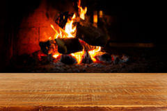 Wooden table over fireplace. Christmas holiday concept Stock Photography