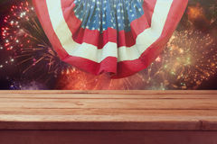 Wooden table over fireworks. 4th of July background. Independence day celebration Stock Photography