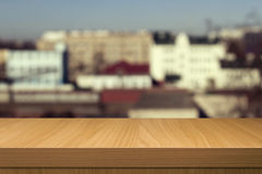Wooden table over outdoor city blur background Royalty Free Stock Photos
