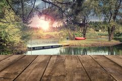 Wooden table perspective and a river landscape in background. stock image
