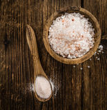 Wooden table with Pink Salt selective focus stock images