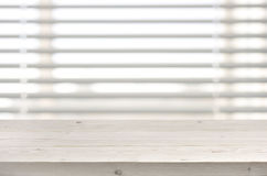 Wooden table from planks on window with venetian blinds background Royalty Free Stock Photography