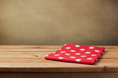 Wooden table with polka dots tablecloth Stock Photos