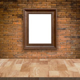 Wooden table and red brick wall with frame picture Royalty Free Stock Photography