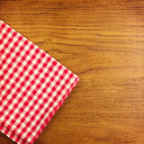 Wooden table with red checked tablecloth. View from top Royalty Free Stock Photo