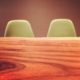 Wooden table and retro style chairs Royalty Free Stock Photo