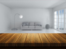 Wooden table with room interior in background Stock Photos