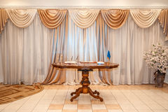 Wooden table in the room. Vintage wooden table standing in the room Royalty Free Stock Image