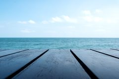 Wooden table with the sea and blue sky royalty free stock images