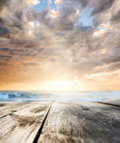 Wooden table at sea. Wooden table and sunset at seaside. Focus on table, blurred background Stock Photos