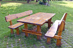 Wooden table and seats in summer park Royalty Free Stock Image