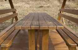 Wooden table and seats stock images