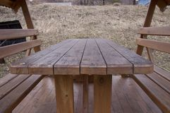 Wooden table and seats royalty free stock photo