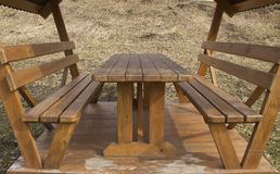 Wooden table and seats royalty free stock image