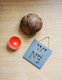 On a wooden table separately worth the red candle. `Wine` tablet with an inscription. Coconut shell on beige wooden table. The composition of red candles and Royalty Free Stock Photography