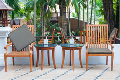 Wooden table set in garden Royalty Free Stock Photos