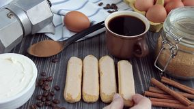 Wooden table with set of ingredients for tiramisu stock video footage