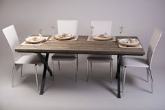 Wooden table setting and decoration for meal time, studio shot Stock Image