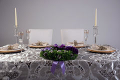 Wooden table setting and decoration for meal time, studio shot Royalty Free Stock Images