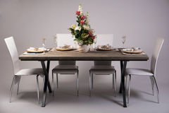 Wooden table setting and decoration for meal time, studio shot Stock Photo
