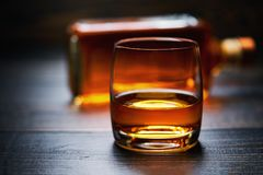 Wooden table with single shots of whiskey Stock Photography