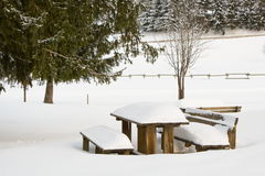 Wooden table snowy Stock Photography