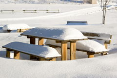 Wooden table snowy. Wooden table and benches in a snowy field Stock Images