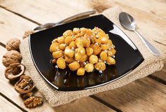 Wooden table with struffoli Stock Image