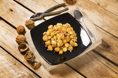 Wooden table with struffoli Stock Photos