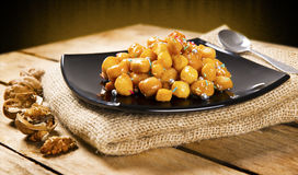 Wooden table with struffoli Royalty Free Stock Photos
