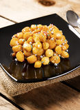 Wooden table with struffoli Royalty Free Stock Image