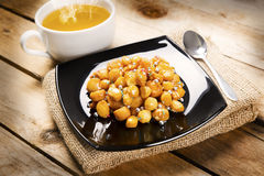 Wooden table with struffoli Stock Photography