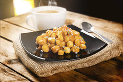 Wooden table with struffoli Stock Images