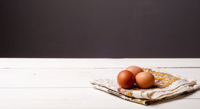 Wooden table and tablecloth Royalty Free Stock Image