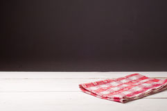 Wooden table and tablecloth Royalty Free Stock Photo