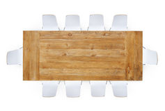 Wooden Table with Ten Chairs Around stock images