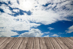 Wooden table or terrace on Deep blue sky and clouds. Space for y Stock Photo