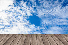 Wooden table or terrace on Deep blue sky and clouds. Space for y Royalty Free Stock Image