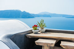 Wooden table on the terrace with sea view