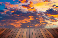 Wooden table or terrace on sunset sky and clouds, color and dark Royalty Free Stock Photography