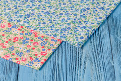 Wooden table with textile tablecloth, top view, horizontal Stock Photo