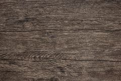 Wooden table texture - dark brown wood background. Wooden table texture, detailed close-up. Dark brown wood background royalty free stock photography