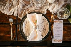 Stylish festive table setting stock photography