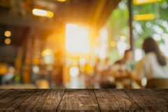 Wooden table top blank space with cafe interior blur design for advertising template royalty free stock images