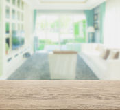 Wooden table top with blur of living room in modern classic style Royalty Free Stock Photography