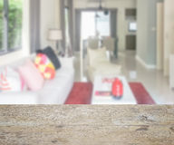 Wooden table top with blur of modern living room and dining table Stock Photos