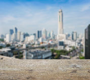 Wooden table top with blurred abstract background of bangkok downtown stock photography