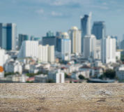 Wooden table top with blurred abstract background of bangkok downtown royalty free stock photo