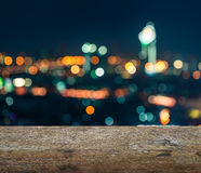 Wooden table top with blurred abstract background of bangkok night Stock Photo